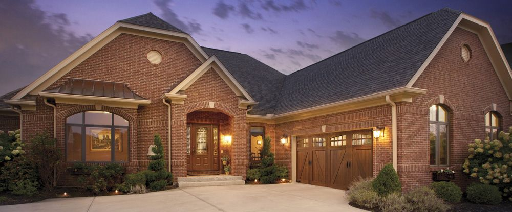 CANYON RIDGE COLLECTION. Faux Wood Carriage House Style Garage Doors.